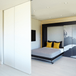 Кровать в стене, плюсы и минусы, механизмы, материалы, критерии выбора